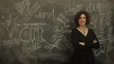 Crista Cloutier in front of chalkboard