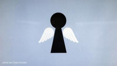 illustration of an angel in a keyhole