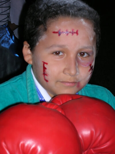 Young boy with boxing gloves