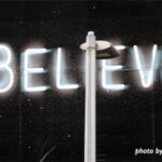 Tacky neon light saying believe