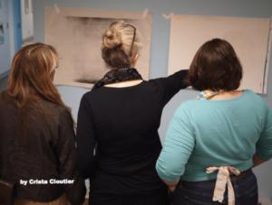 3 women critiquing artwork