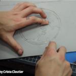 Artist carving the world in linoleum