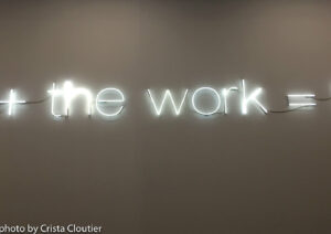 Neon sign that says the work