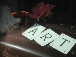 Playing cards spelling out art